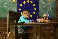 New technology. Little child use laptop computer in classroom with eu flag, new technology. New technology in elementary. School. New technology for back to Stock Photos
