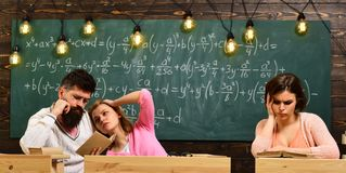New technology in modern school. Friendship. Friends make decision and solve problem. Teamwork at education centre Royalty Free Stock Photo