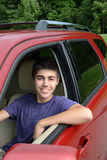 New teenage driver sits in his new car Stock Photo