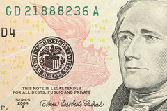 New ten dollar bill details. Macro of Hamilton with some of the new design elements such as the red torch Stock Photos
