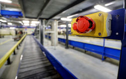 New terminal of Zagreb Airport. Red emergency stop button on conveyor belt for luggage in basement of the the new Terminal of Franjo Tudjman airport in Zagreb Stock Image