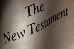 The New Testament. The title page of an old English Bible's New Testament part under dramatic lighting Stock Photo