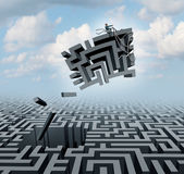 New Thinking Concept. New thinking and empowerment concept as a businessman riding a chunk of a maze or labyrinth as a business or life success concept and Royalty Free Stock Photography