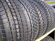 New Tires for Sale 2. New tires assorted sizes and assorted brands on display ready for sale Stock Images