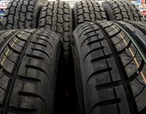 New tires on the shelf at car parts store stock photo Royalty Free Stock Images