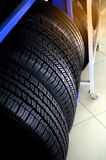 New tires that is stored on the shelf. Car workshop, car repair royalty free stock photo