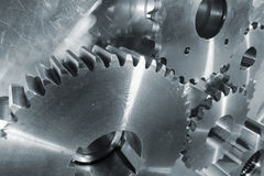 New titanium and steel gears. Industry gears and wheels, titanium and steel and in a duplex blue toning concept Stock Photography