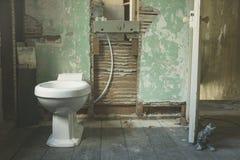 New toilet in derelict bathroom Stock Photography
