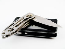 New Touchscreen Cell Phone and Hunting Knife Blade Royalty Free Stock Images