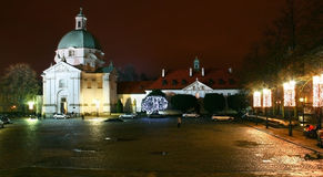 New Town Market in Warsaw at night. New Town Market in Old Town district in Warsaw, Poland, at night with st. kazimierz church Royalty Free Stock Images