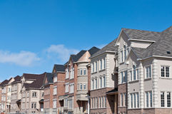 New Townhomes Under Construction. A newly built row of townhouses nears completion Stock Images