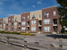 New Townhouse or Condo Type Homes. Made of different shades of brick and vinyl siding Stock Images
