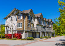 New townhouses on sunny day. Complex of new townhouses in Burnaby, Canada Stock Photo