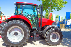 New tractor. Red Tractor exposed for sale in agricultural fair,photography Royalty Free Stock Images
