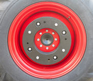 New tractor red tire wheel detail Stock Images