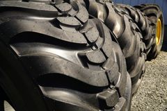 New Tractor Tires. A row of large tractor tires foe sale Stock Photo