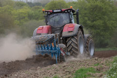 New tractor used to plow field Stock Photography