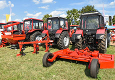 New tractors and agricultural machineries. At the fair Royalty Free Stock Photography
