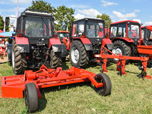 New tractors and agricultural machineries. At the fair Royalty Free Stock Images