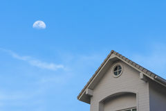 New traditional gable roof  house under moon sky. New traditional gable roof house under blue moon cloud sky Royalty Free Stock Photos