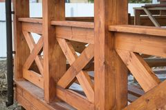 New treated pine handrails on the gazebo fencing. Building. stock image