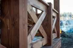 New treated pine handrails on the gazebo fencing. Building royalty free stock photo