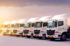 New truck fleet is parking at yard during sunset. As for transportation service mode royalty free stock photography