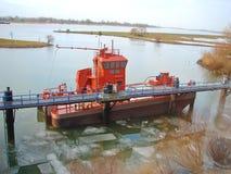 New tugboat near the pier. Stock Photo