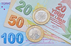 New Turkish 1 Lira coin on banknotes royalty free stock image