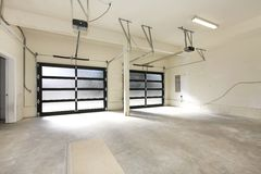 New two car garage with glass doors. Stock Photos