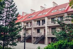 The new two-storey residential building with green area beside Stock Photo