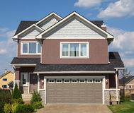 New two-storied brick cottage with garage Royalty Free Stock Image