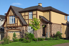 New two-storied brown stone cottage. Royalty Free Stock Image