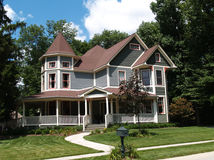 New Two Story Victorian Historical Styled Resident. New two story Victorian residential home with vinyl or board siding on the facade styled after an old Stock Photo