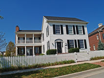 New Two-Story White Home with Fence Stock Photography