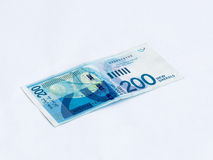 A new type of banknote worth 200 Israeli shekels  isolated on a white background Stock Photo