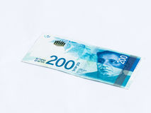 A new type of banknote worth 200 Israeli shekels isolated on  a white background. A new type of banknote worth 200 Israeli shekels isolated on a white background Stock Photo