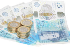 The new UK polymer five pound note and the new 12 sided £1 coin Stock Image