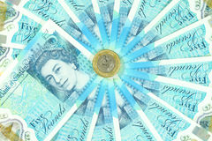 The new UK polymer five pound note and the new 12 sided £1 coin Stock Photo