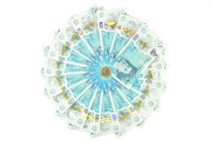 The new UK polymer five pound note and the new 12 sided £1 coin Royalty Free Stock Image