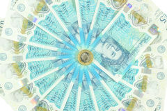 The new UK polymer five pound note and the new 12 sided £1 coin Royalty Free Stock Photo