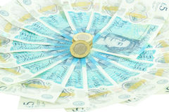 The new UK polymer five pound note and the new 12 sided £1 coin Royalty Free Stock Images