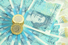 The new UK polymer five pound note and the new 12 sided £1 coin Stock Images