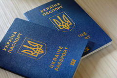 New ukrainian blue biometric passport with identification chip on wooden background with copy space. Stock Photography