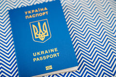 New ukrainian blue international biometric passport with identification chip on white and blue background with copy space. Selective focus Stock Photo