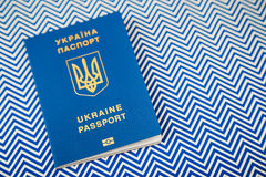 New ukrainian blue international biometric passport with identification chip on white and blue background with copy space. Selective focus Royalty Free Stock Image