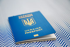 New ukrainian blue international biometric passport with identification chip on white and blue background. Selective focus Stock Photo