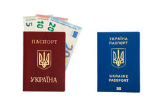 New ukrainian international biometric passport vs old ukrainian red international passport with 35 euro banknotes cash inside Royalty Free Stock Photo