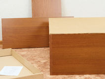 New unassembled cabinets. Furniture Assembly. Stock Photo
