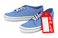 New Unbranded Blue Denim Sneakers with Sale Tag. 3d Rendering Royalty Free Stock Photography